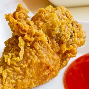 Fried chicken legs served with  tomato sauce and chili sauce