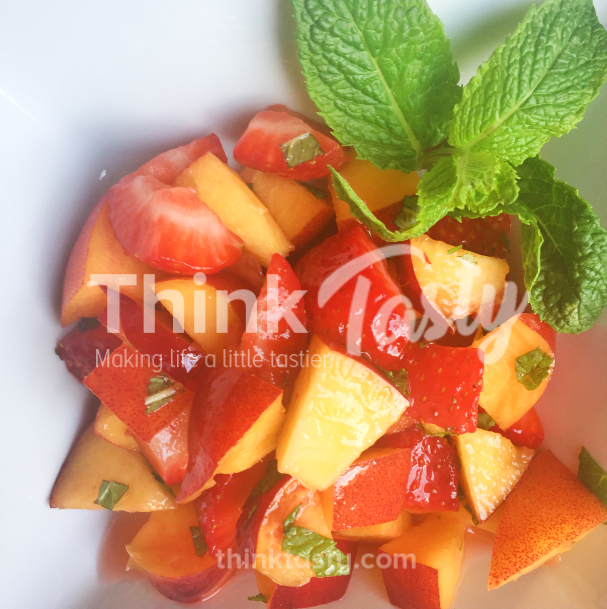fruit salad of nectarines and strawberries with mint dressing