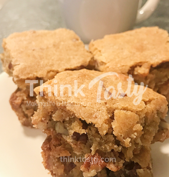 These indulgent blondies are gooey, full of pecans, and have a delightful hint of bourbon.