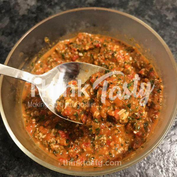 Pesto made with roasted red pepper, parsley, walnuts, and parmesan