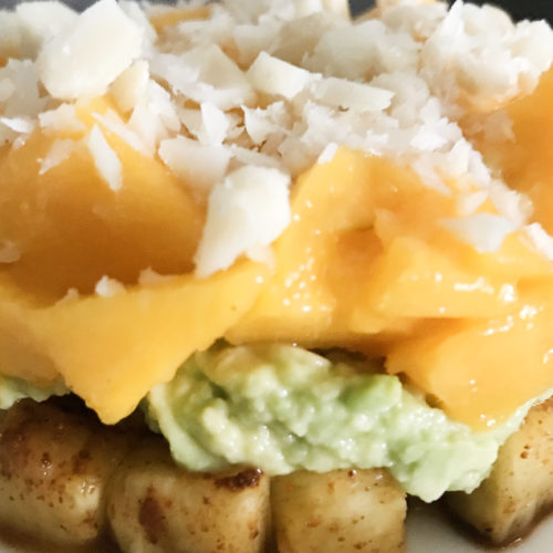 Spicy pineapple mashed avocado diced mango and chopped macadamia nuts