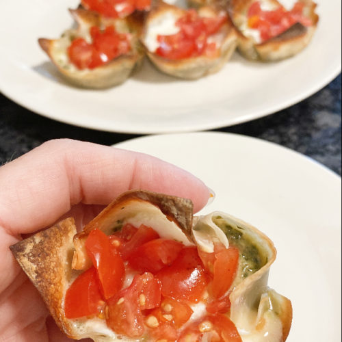 pesto mozzarella and tomato filled wonton cups