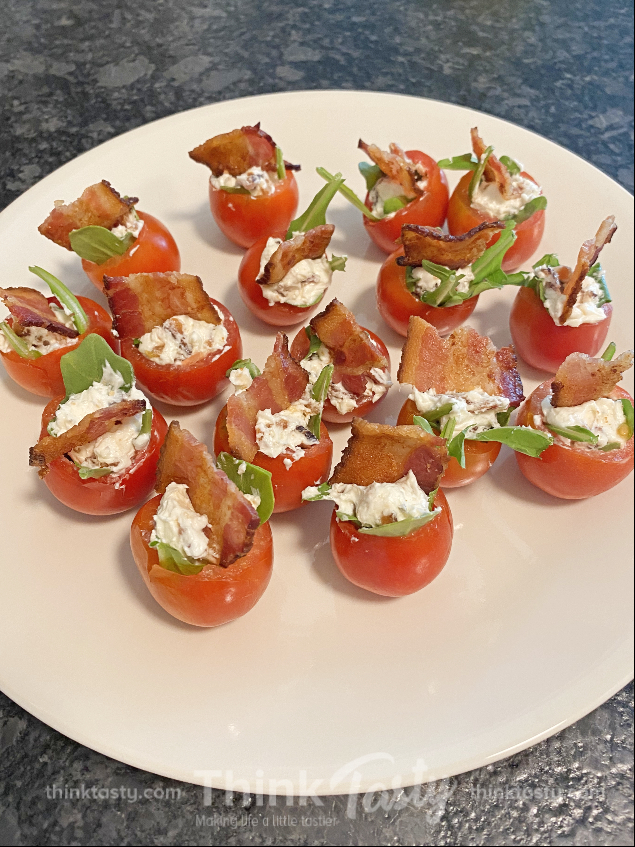 Cherry tomatoes stuffed with bacon, lettuce, and cheese