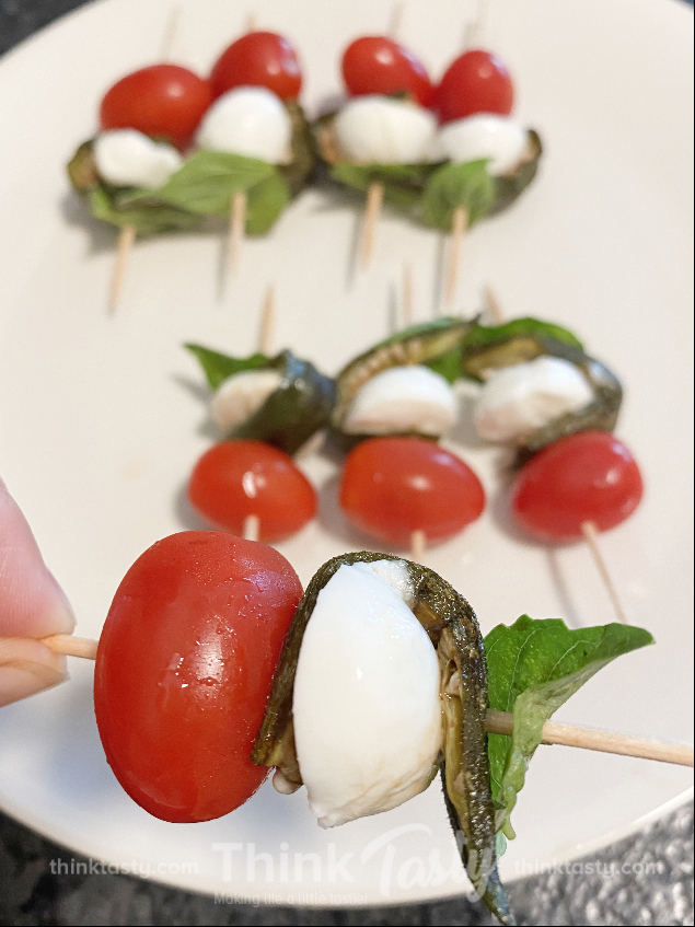 okra skewered with mozzarella, tomato, and basil