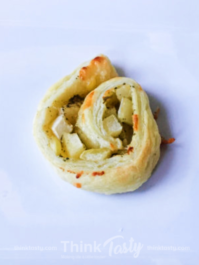 puff pastry wrapped around apples and cheddar