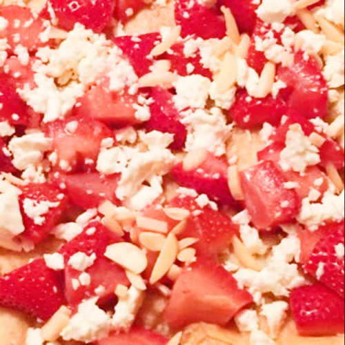 Pizza topped with strawberries and feta
