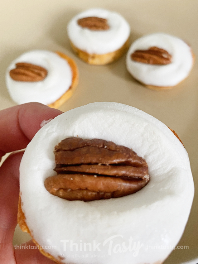 sweet potato round topped with marshmallow and pecan